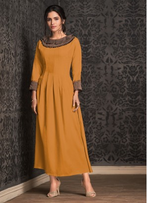 Absorbing Fancy Rayon Mustard Party Wear Kurti
