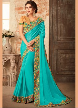 Aqua Blue Faux Georgette Embroidered Traditional Designer Saree