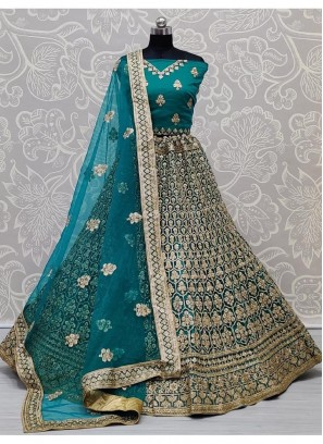 Arresting Teal Dori and Zari Embroidery Bridal Net Lehenga Choli