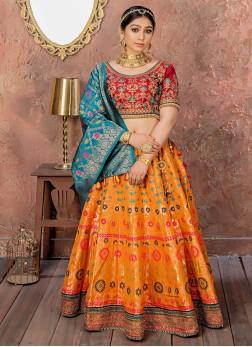 Banarasi Silk Embroidered Orange Designer Lehenga Choli