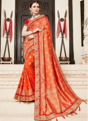 Bedazzling Orange Traditional Designer Saree