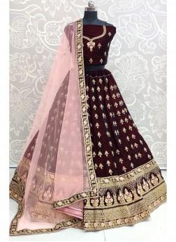 Bewitching Bridal Wear Thread & Dori Work On Lehenga Choli In Maroon