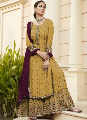 Bewitching Mirror Work Sharara Style Salwar Suit In Mustard - Marron