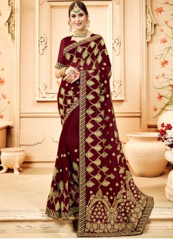 Distinctively Faux Georgette Brown Embroidered Classic Designer Saree