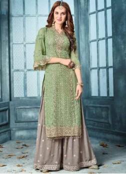 Engrossing Green Wedding Designer Pakistani Suit