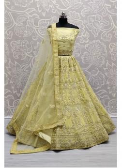 Eye-catching Light Yellow corded embroidery on net Designer Lehenga choli