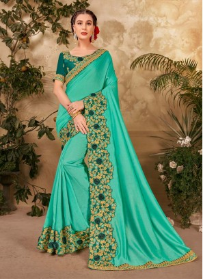 Famous Cut Peaich Embroidery Work Saree In Turquoise
