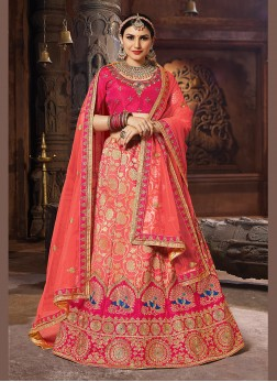 Graceful Embroidered Peach Banarasi Silk Designer Lehenga Choli