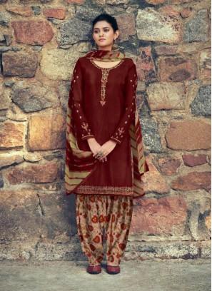 Jari Embroidery French Crap Salwar Suit In Rust