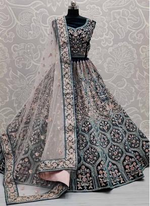 Mesmerizing Multi Thread Embroidery Velvet Bollywood Lehenga Choli In Teal