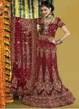 Pleasing Patch Border Net Bridal Lehenga Choli in handwork