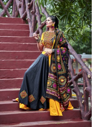 Pulchritudinous Black And Orange Navratri Lehengacholi