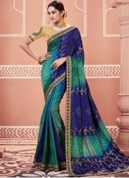 Spellbinding Embroidered Faux Georgette Blue and Sea Green Shaded Saree