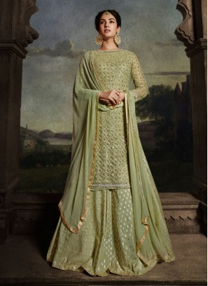 Stupendous Embroidery Work On Net Sharara Style Suit In Sea Green