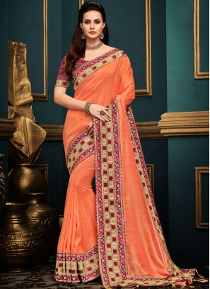 Thrilling Art Silk Orange Embroidered Traditional Designer Saree