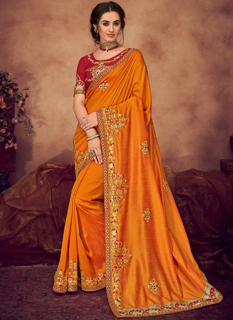 Arresting Embroidered Orange Classic Saree