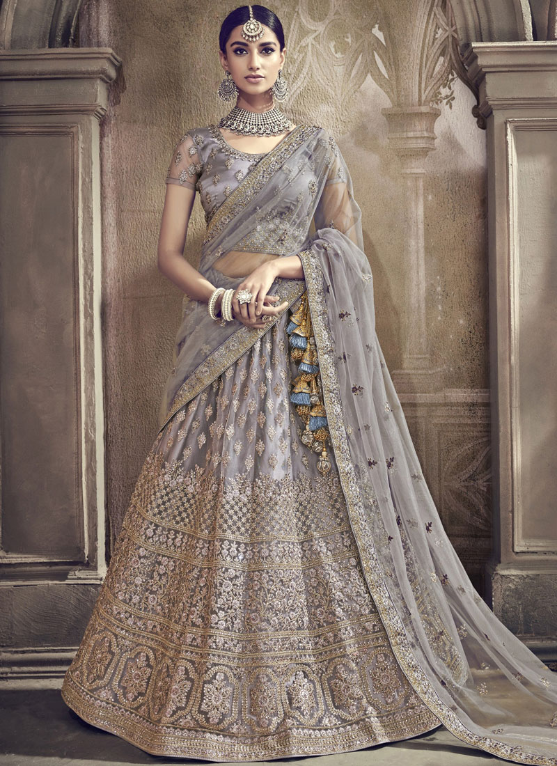 0b2c65b0d9 Net Grey Embroidered Lehenga Choli. Hover to zoom